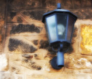 Lantern on a stone wall Royalty Free Stock Image