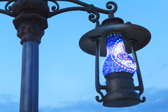 Lantern on the street its original form as an antique lamp. Royalty Free Stock Photo