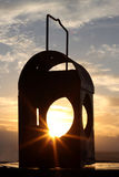 Lantern Sunrise. Sunrise as viewed through an antique gas lantern stock images