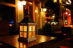 Lantern on a table at night Stock Photography