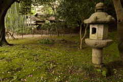 Lantern and traditional house  in japaneese garden Sankei-en Royalty Free Stock Image