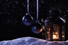 Lantern with two hanging christmas balls Royalty Free Stock Images