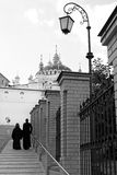 Lantern, two priests and church.Kiev-Pechersk Lavra monastery in Kiev. Ukraine Stock Photo
