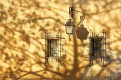 Lantern, two windows and shadows Royalty Free Stock Image