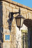 Lantern vintage on the wall of an old stone Royalty Free Stock Photography