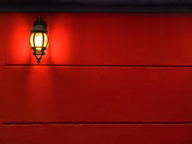 Lantern on wall. Red wall plenty of copyspace Stock Images
