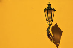 Lantern on the wall. Metal lantern on the wall Stock Images
