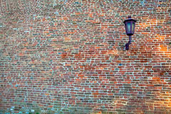 Lantern on a wall with bricks Stock Photo
