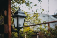 Lantern on the wall of the gazebo, close-up. Lantern on the wooden wall of the gazebo, close-up Royalty Free Stock Images