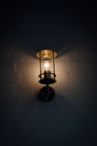 Lantern at wall illuminating darkness Royalty Free Stock Photo