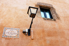 Lantern on the wall in old town on the castle in Tossa de Mar Royalty Free Stock Photography