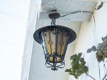 Lantern on the wall on a village house Stock Images