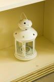 Lantern white. Lantern with white stars is on the shelf Stock Photo