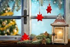 Lantern on window sill in winter Stock Photos