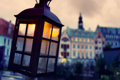 Lantern with a yellow light on the background of the Old Town Stock Images