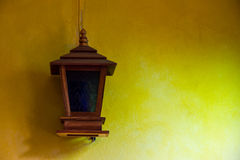 Lantern on a yellow wall Stock Photos