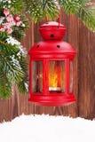 Lanterna da vela do Natal no ramo de árvore do abeto Imagens de Stock Royalty Free