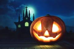 Lanterna della presa o della testa della zucca di Halloween sul pavimento di legno Immagine Stock Libera da Diritti