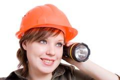 Lanterna e un casco arancione luminoso Immagine Stock