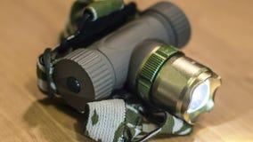 Lanterna elétrica do farol do turista na tabela Imagens de Stock Royalty Free
