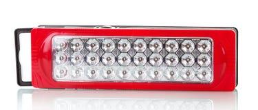 Lanterna elétrica plástica do diodo emissor de luz do vermelho isolada no fundo branco Fotografia de Stock Royalty Free