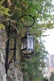 Lanterna forjada bonita na parede do castelo de Mônaco Imagens de Stock Royalty Free
