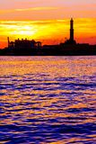 Sunset at Genoa`s port, silhouette of the Lanterna, Italy