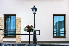 Lanterna, parete e due finestre Immagine Stock Libera da Diritti