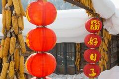 Lanterna rossa e neve bianca Fotografia Stock