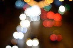 Lanternas de Bokeh da cidade da noite Fotografia de Stock Royalty Free