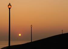 Lanternas pela água no nascer do sol Imagens de Stock Royalty Free