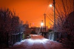 Lanterne accese della strada campestre al tramonto Fotografia Stock Libera da Diritti