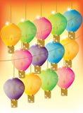 Lanterne cinesi variopinte su fondo arancio Fotografie Stock
