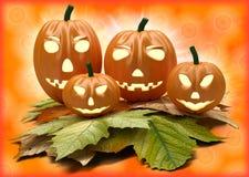 Lanterne della zucca di Halloween su fondo arancio Immagini Stock Libere da Diritti