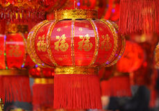 Lanterne rosse, petardi rossi, peperone, rosso ognuno, nodo cinese rosso, pacchetto rosso Il festival di primavera sta venendo Immagini Stock