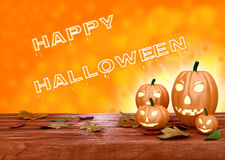 Lanternes de potiron de Halloween sur le fond orange Photos stock
