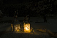 Lanterns. Candle lanterns in snow at night Stock Image