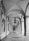 Lanterns and arches at Commerce square. Praca do Comercio in Lisbon, Portugal. Aged photo. Black and white royalty free stock images