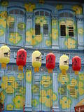 Lanterns in Chinatown, Singapore. A row of lanterns hanging before a shophouse in Chinatown, Singapore. The front facade of the shophouse was painted blue with royalty free stock photography