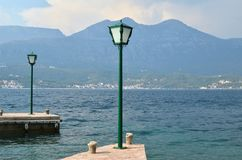 Lanterns on docks. Green lanterns on docks with a sea view Stock Image
