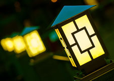 Few yellow lanterns in dark Stock Images