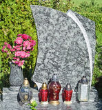 Lanterns and flowers on the tombstone Stock Photo