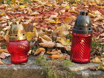 Lanterns on the grave in autumn Stock Image
