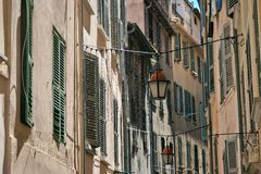 Lanterns hanging on a narrow street of the old Royalty Free Stock Photos