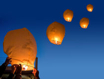 Lanterns launch in dark night sky Stock Images