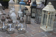 Lanterns and lights for sale at flea market Stock Photo