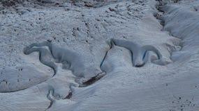 Water Stream Cutting Through Snow stock photo