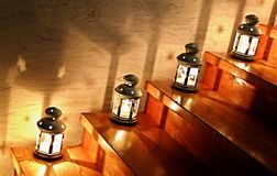 Lanterns on a Staircase. With star shades and lights on the wall stock photo