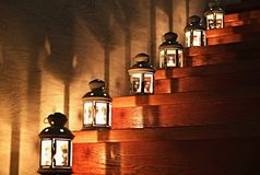Lanterns on a Staircase. With star shades and lights on the wall Stock Photography