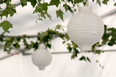 Lanterns in a summer pavilion Stock Photo